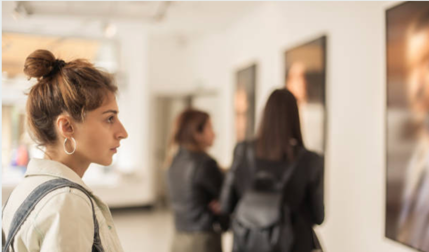 Woman looking at art on the wall in gallery