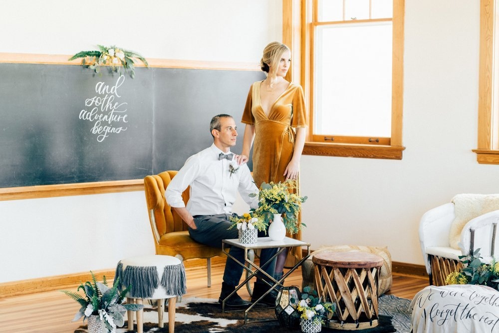 Couple posing in wedding space at The Schoolhouse in Parker, CO.
