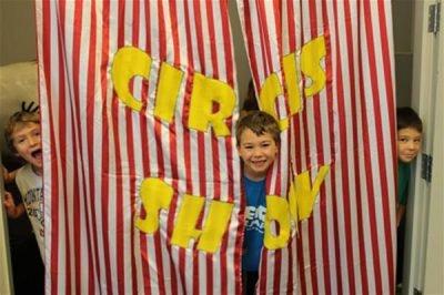 Teach for Us Circus Show kids behind curtain