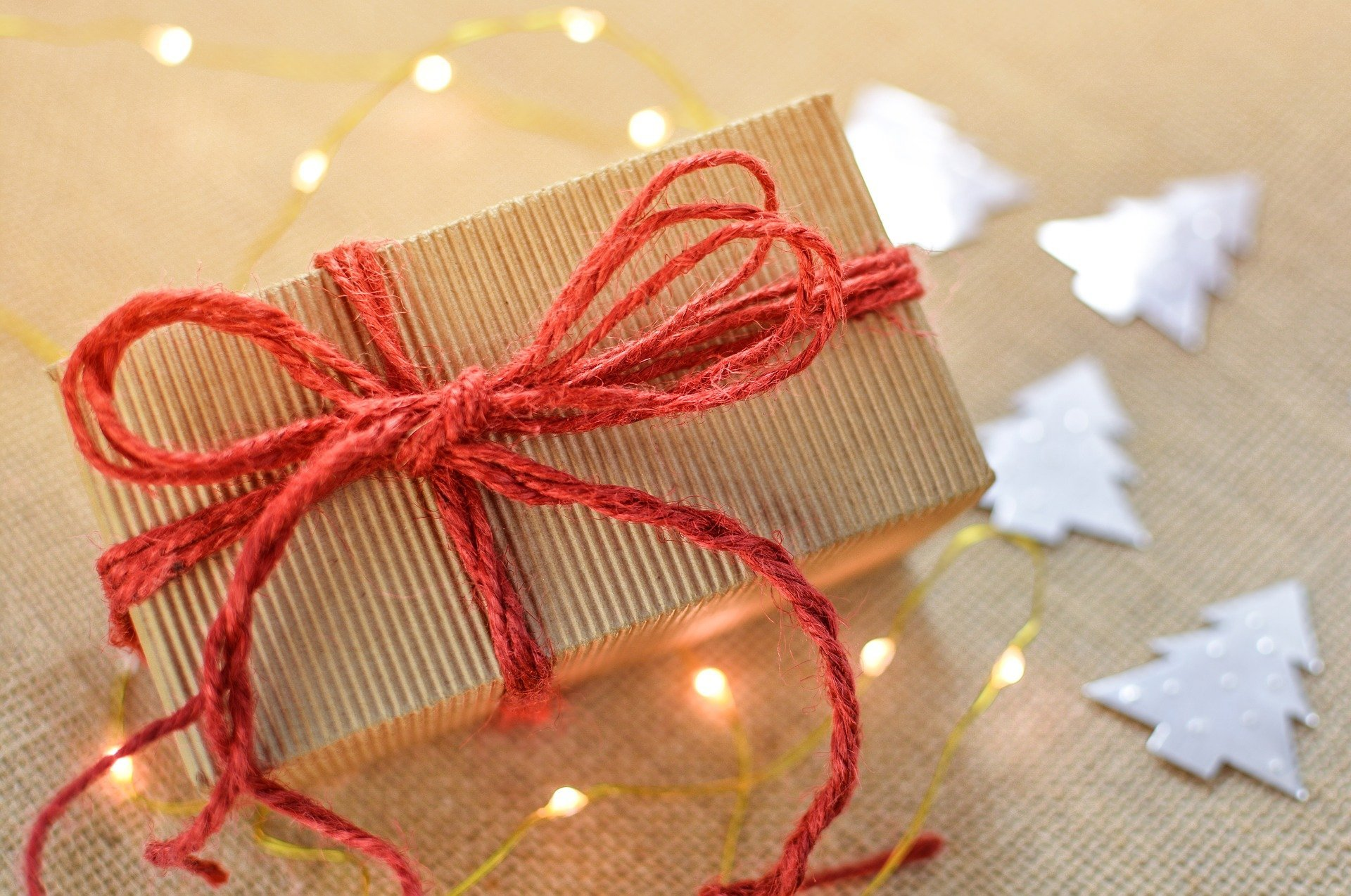 Holiday gift wrapped in red string